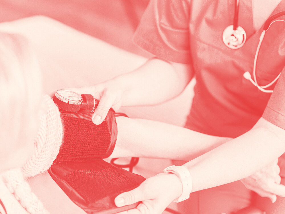 A nurse takes the blood pressure of a patient.
