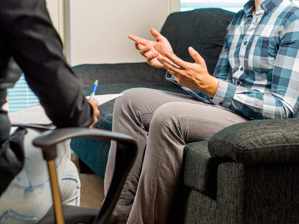 Psychologist working with a client in a counseling room.