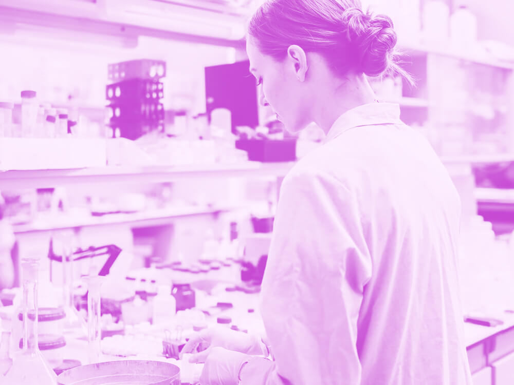 A student in a lab setting.