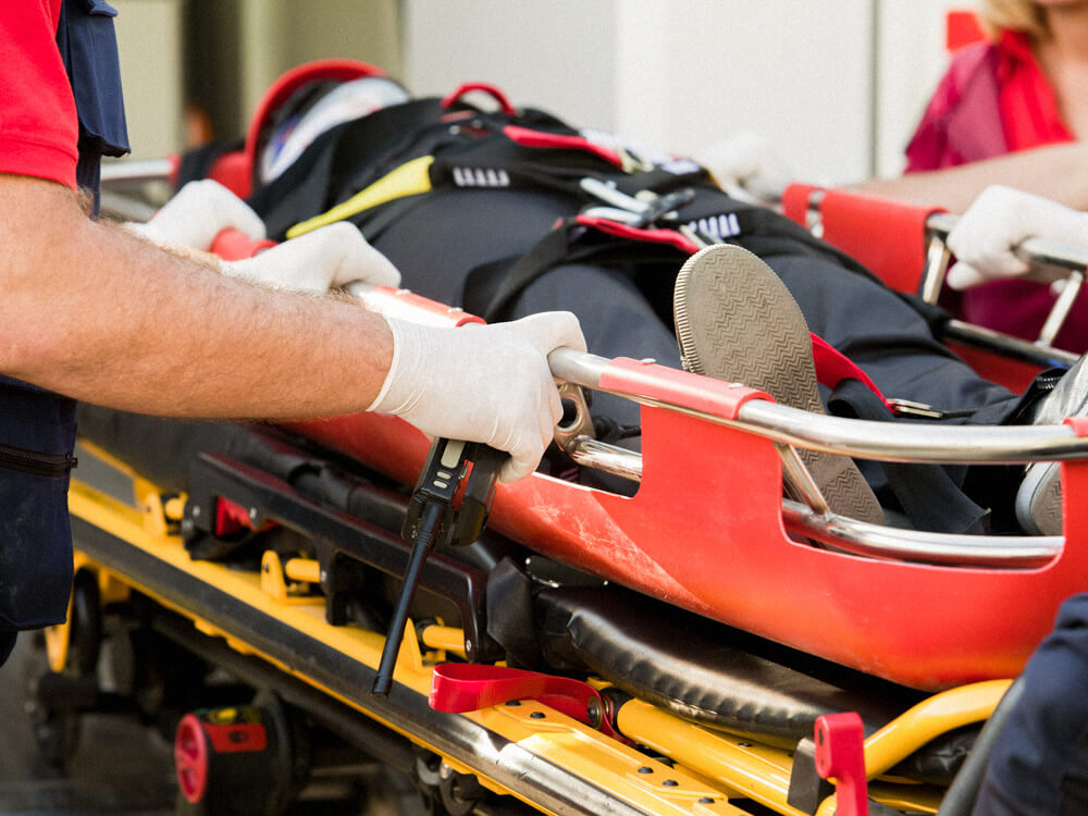 Paramedics transporting a patient on a stretcher. Close-up.