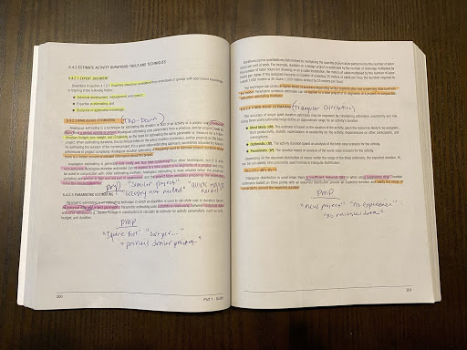 Open textbook with highlighted sections