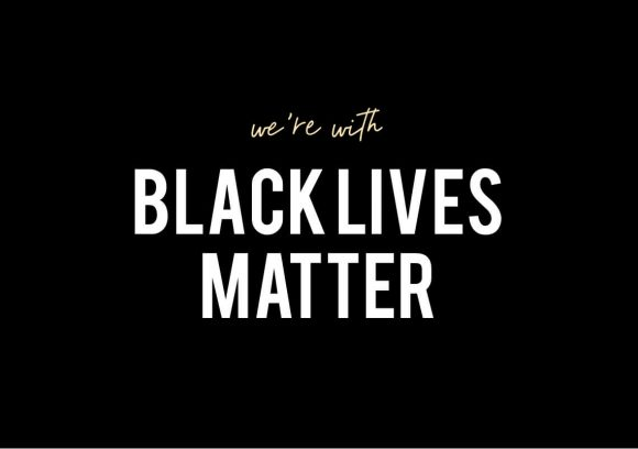 White text on black background saying 'we're with Black Lives Matter'.