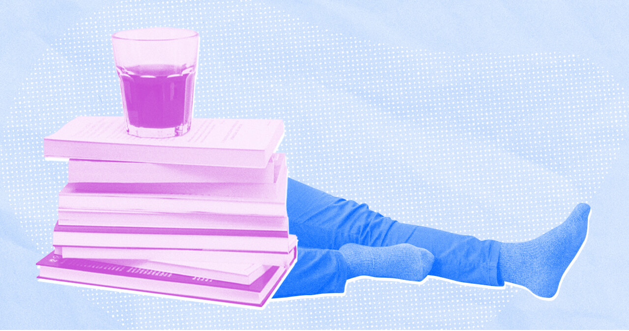 Composite image of a stack of books and coffee on top of a person's body with their legs sticking out.