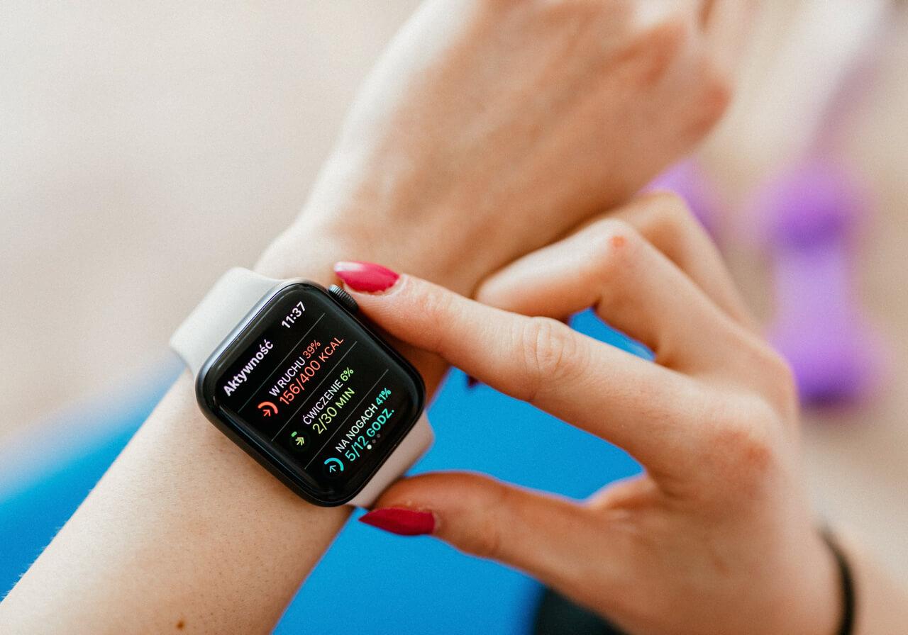 A person checks their statistics on their smartwatch.
