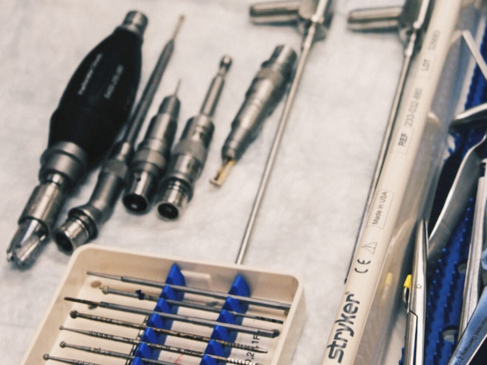 Surgey tools placed across medical tray
