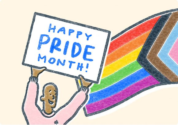 Man holding Happy Pride Month sign.